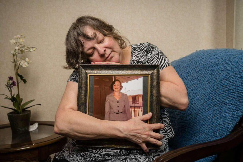 Summer's grieving mother, Jeanine, clings to her picture. Jeanine wanted Summer's story told in hopes of helping others. (Tomas Ovalle / Special to The Chronicle)